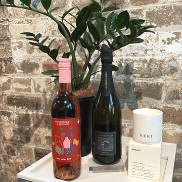 Mother's day gift pack 1 includes a bottle of Gorman Yarra Valley Rose, a bottle of Tasmanian Sparkling & a free candle.