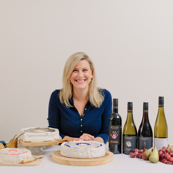 justine schofield with wine bottles and cheese